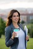Young female entrepreneur taking a coffee break Stock Image