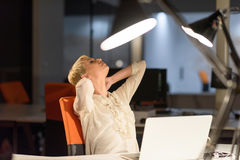 Woman working on laptop in night startup office Royalty Free Stock Photos