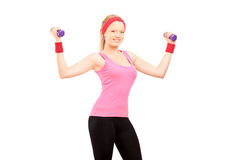 Young female excercising with dumbbells Stock Photos