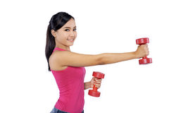 Young female excercising with dumbbells Stock Images