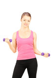 Young female excercising with dumbbells Stock Photo