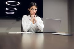 Young female executive during meeting in office conference room royalty free stock photos