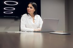 Young female executive smiling during meeting in office conference room stock images