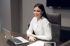 Young female executive smiling during meeting in office conference room stock photo