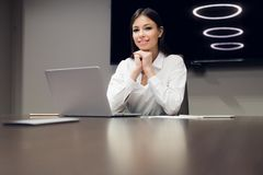 Young female executive smiling during meeting in office conference room royalty free stock image