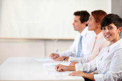 Young female executive smiling at you Royalty Free Stock Photo
