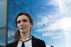 Female executive standing in office premises. Young female executive standing in office premises Stock Photos