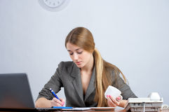 Young female executive writing Royalty Free Stock Photos