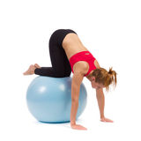 Young female exercise on fitness ball Royalty Free Stock Photography