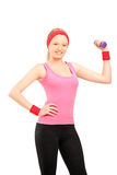Young female exercising with a dumbell Royalty Free Stock Photo