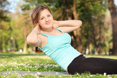 Young female exercising in a park Royalty Free Stock Photography