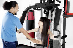 Young female exercising with a personal trainer Stock Image