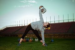 Young female exercising at stadium. royalty free stock photography