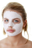 Young female face with clay mask Royalty Free Stock Photos