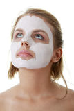 Young female face with clay mask Royalty Free Stock Photo