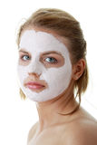 Young female face with clay mask Stock Photos