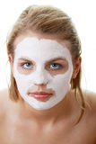 Young female face with clay mask Stock Photo