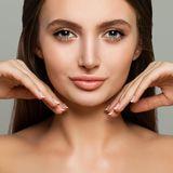 Young Female Face Closeup. Cute Model Woman with Healthy Skin. And Manicure Royalty Free Stock Images
