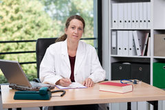 Young female family doctor in her office Stock Image