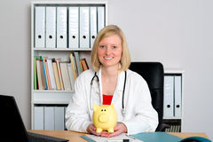 Young female family doctor in her office Stock Photos