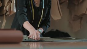 Young female fashion designer or seamstress in her textured studio. stock video footage