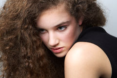 Young female fashion model with curly hair Royalty Free Stock Photos