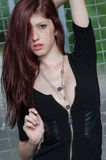 Young female fashion model with red hair and nice neckline Stock Photos