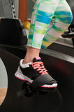 Young female feet exercising and pedaling the stationary bicycle Royalty Free Stock Photo