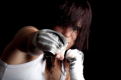 Young female fighter on black background Royalty Free Stock Images
