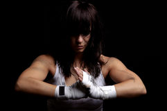 Young female fighter on black background Stock Photos