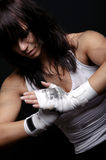 Young female fighter on black background Royalty Free Stock Photos