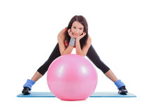 Young female with fitball over white Stock Images
