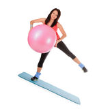 Young female with fitness ball in sport center Royalty Free Stock Photo