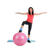 Young female with fitness ball in sport center Stock Photo