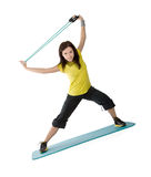 Young female with fitness expander in stretching Stock Images