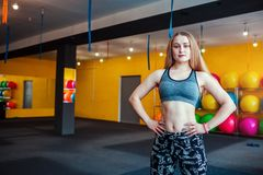Young female fitness instructer standing at the gym. Sportive profession concept. Stock Photo