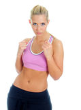Young female fitness trainer. Holding fists up. Isolated on white Stock Photos