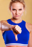Young female fitness trainer dissaproving Royalty Free Stock Photo