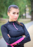 Young female fitness trainer poses during cross-fit break Royalty Free Stock Photo