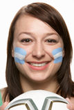 Young Female Football Fan With Argentinian Flag. Painted On Face Royalty Free Stock Images