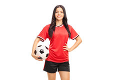 Young female football player holding a ball Stock Photos