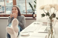 Young woman freelancer indoors home office concept winter atmosphere drinking coffee relaxation Royalty Free Stock Photos