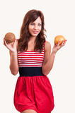 Young female with fresh grapefruit and coconut in her hands Stock Images