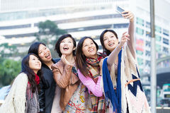 Young female friend taking selfie in Hong Kong Stock Photo