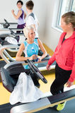 Young female friends chatting in fitness center Royalty Free Stock Image