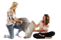 Young female friends enjoying pillow fight Royalty Free Stock Images