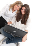 Young female friends with laptop Stock Image