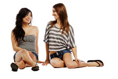 Young female friends looking at each other Stock Photos