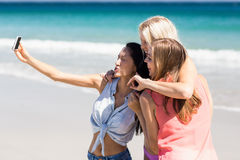 Young female friends taking selfie Stock Image