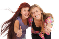 Young female friends with thumbs up Stock Photos